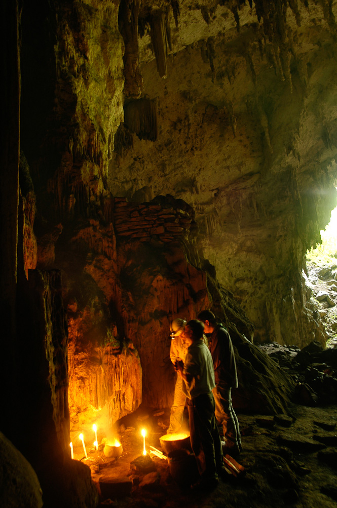 John Climaco, Tony Bacon, and local chief perform a ritual to ask the gods of Naj Tunich for permission to enter the cave