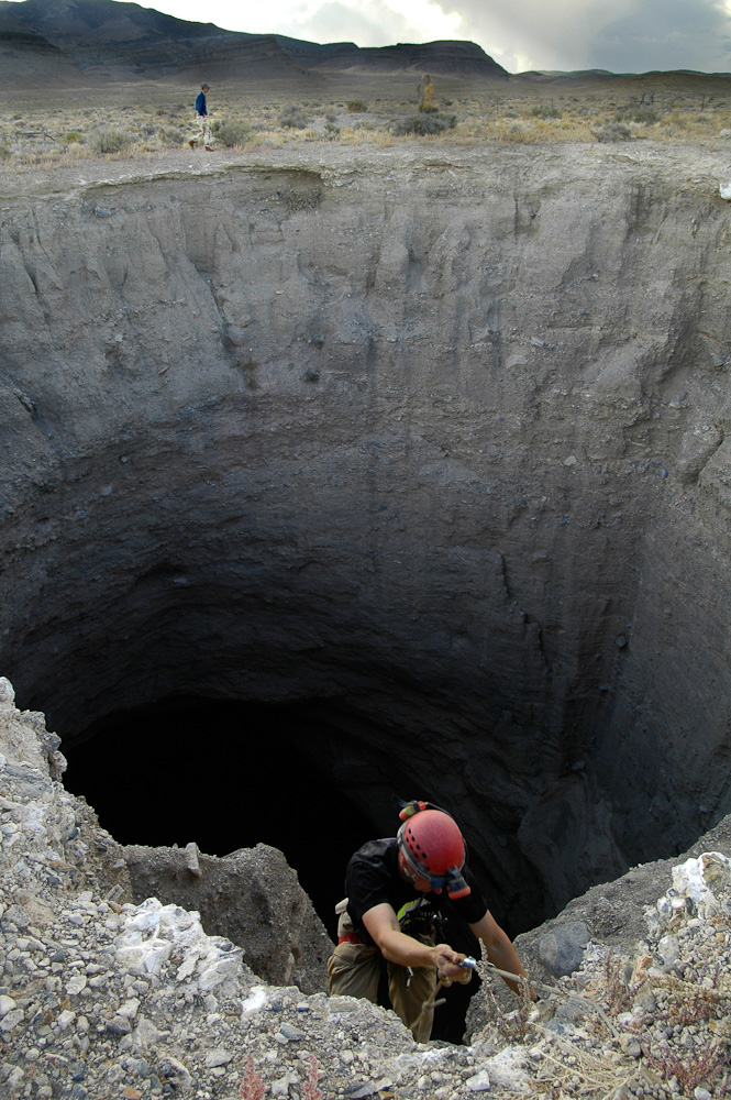 Jon Jasper rappelling into Mystery Hole, a Lake Bonneville sink hole