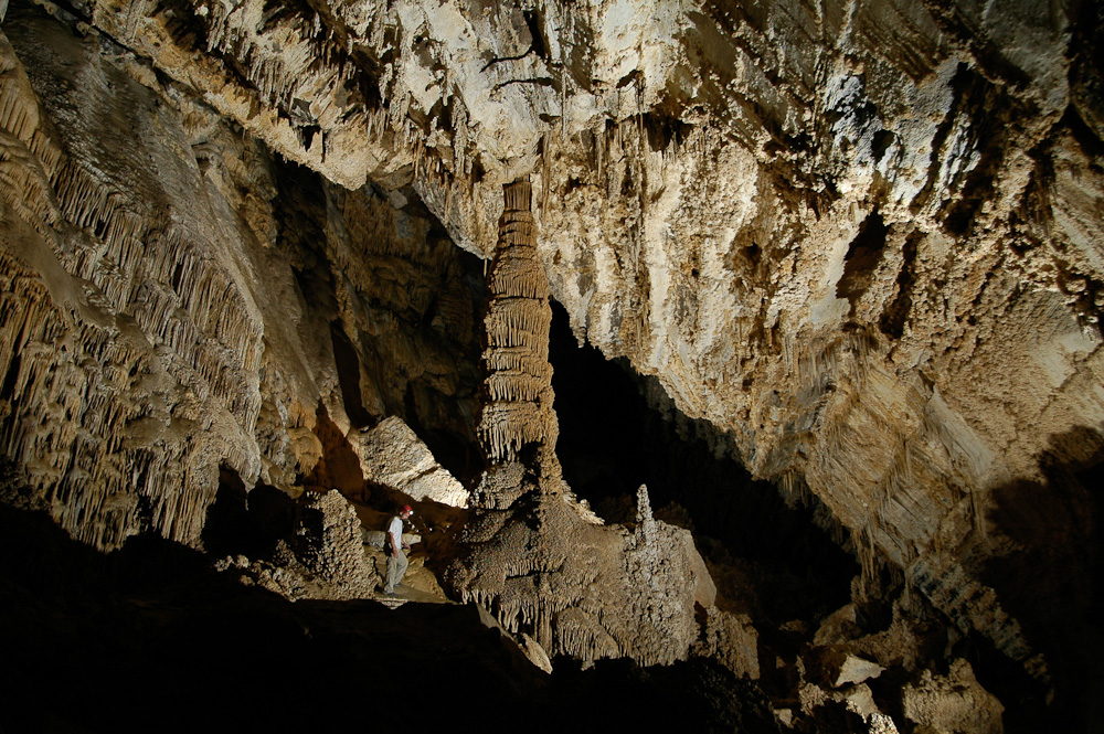 Jason Mateljak by a large column in Whipple Cave