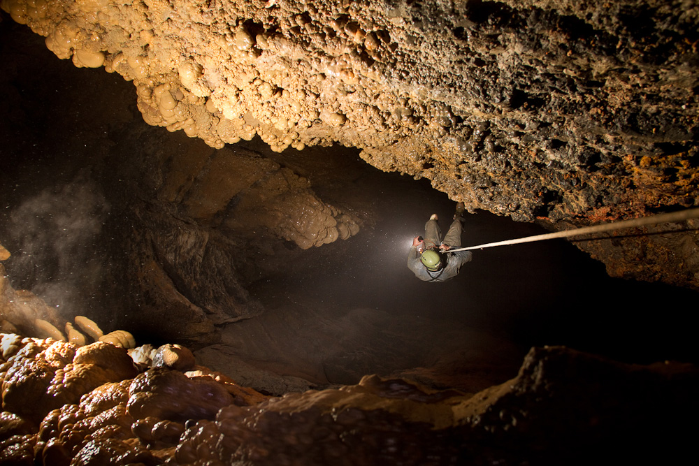 Lance Dickey rappells down the 350 foot Fantasy Well Pit in Nielson's Well