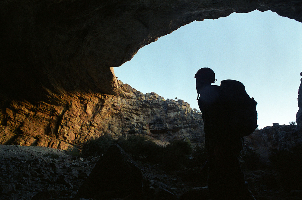 A caver emerging from Friberg Cave