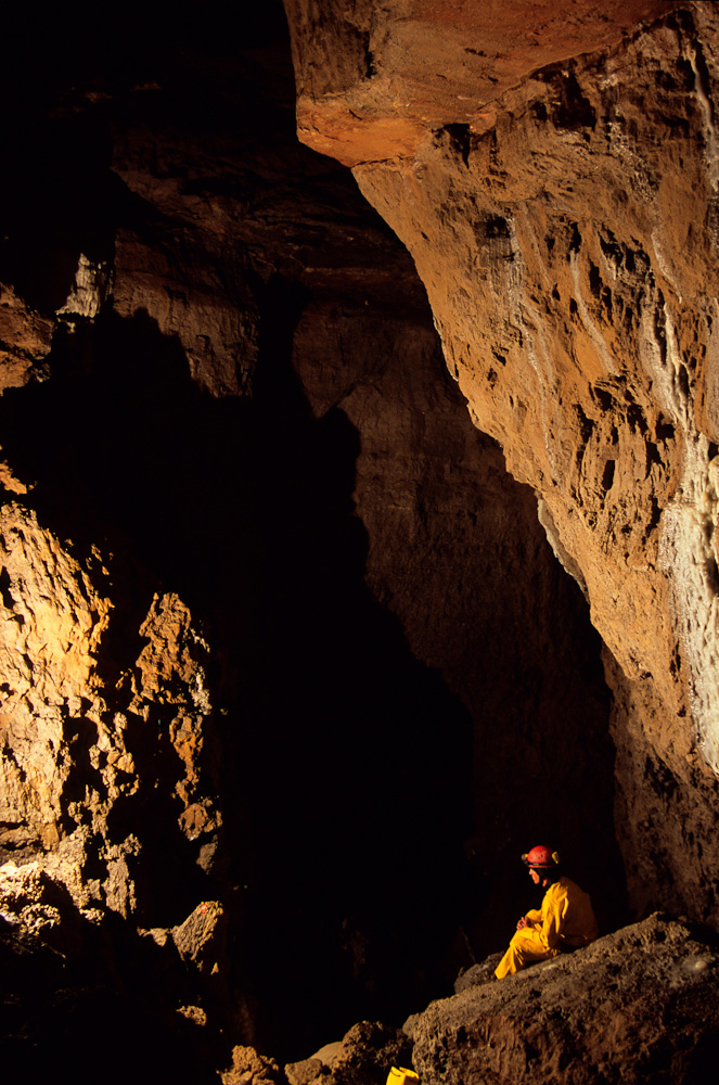 Ryan Shurtz at the bottom of a cave lead he discovered in Main Drain Cave